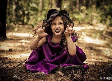 menina maquiada de bruxa